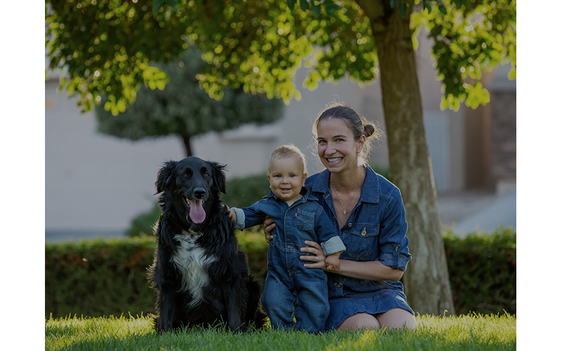 Woman, child, and dog smiling
